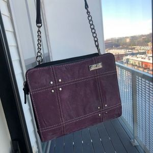 Small black purse with removable purple liner